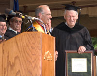 Photo of Doc Watson receiving honorary degree from Wilkes Community College